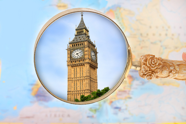 Map of Europe with magnifying glass looking in on Big Ben in London, England