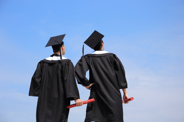 Back view of graduates student look blue sky and think future